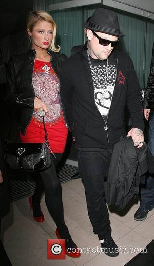 Paris Hilton and her boyfriend Benji Madden of rock group 'Good Charlotte' leaving their hotel. Paris is wearing a Lamis...