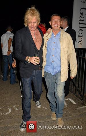 Rhys Ifans and Friend