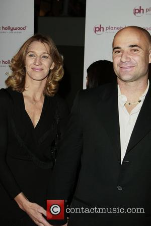 Agassi Tearfully Retires From Tennis