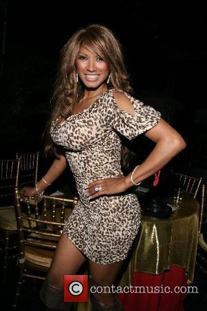 Traci Bingham Hot August Nights charity event, benefiting the Susan G. Komen Breast Cancer Foundation the Playboy Mansion Los Angeles,...
