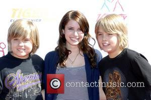 Dylan Sprouse, Cole Sprouse and Emma Roberts