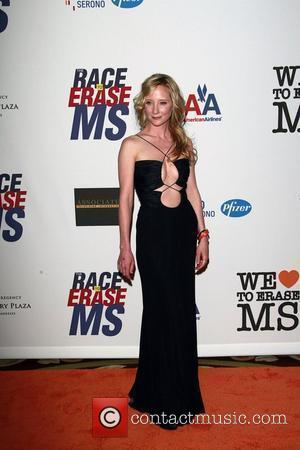 Heche Proud Of Her Stay-at-home Husband