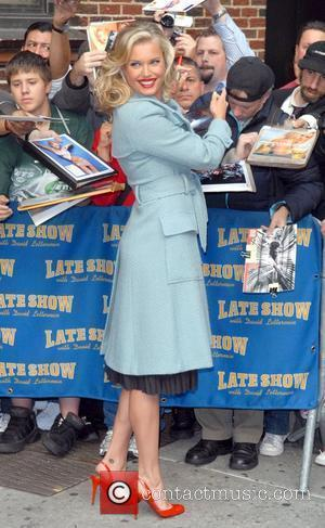 Rebecca Romijn Stamos and David Letterman
