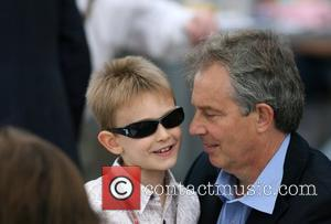 Tony Blair  looking relaxed as he watches the annual Red Bull Air Race 2007 with his son Leo Blair,...