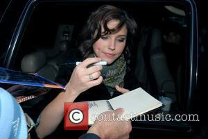 Sophia Bush signs an autograph while departing ABC Studios after appearing on 'Live with Regis and Kelly' New York City,...