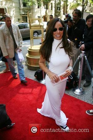 Melissa Rivers wearing sneakers with her gown...