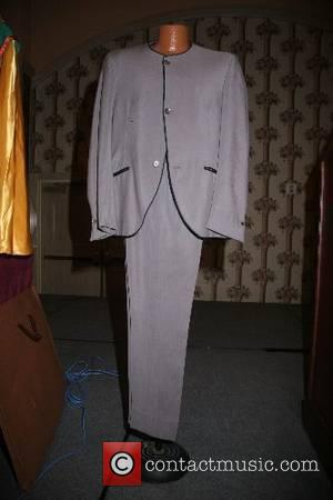 The John Lennon legendary beige mohair stage suit he wore in 1963  The Rock 'N' Roll Celebrity Memorabilia Fame...