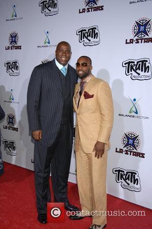 Magic Johnson & NBA Player Baron Davis Baron Davis and Paul Pierce's LA Stars 'Rodeo Drive Experience' - Arrivals Beverly...