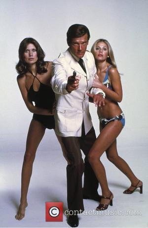 *SIR ROGER MOORE CELEBRATES HIS 80TH BIRTHDAY ON 14TH OCTOBER 2007  Maud Adams, Roger Moore (as James Bond) and...
