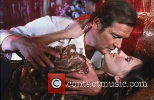 *SIR ROGER MOORE CELEBRATES HIS 80TH BIRTHDAY ON 14TH OCTOBER 2007  Roger Moore (as James Bond) and Maud Adams...