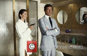 *SIR ROGER MOORE CELEBRATES HIS 80TH BIRTHDAY ON 14TH OCTOBER 2007  Maud Adams and Roger Moore (as James Bond)...