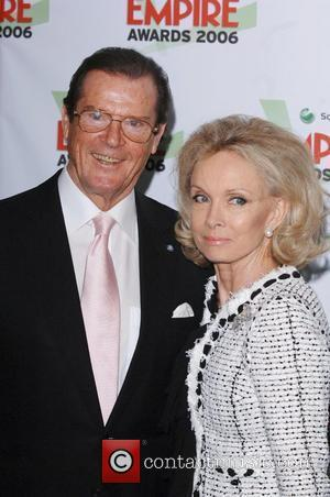 *SIR ROGER MOORE CELEBRATES HIS 80TH BIRTHDAY ON 14TH OCTOBER 2007  Roger Moore and wife Christina Kiki Tholstrup arrives...