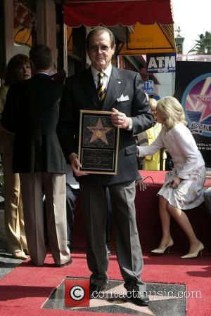 Roger Moore Roger Moore honoured with the 2,350th star on the Hollywood Walk of Fame Hollywood, California - 11.10.07