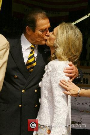 Roger Moore and wife Christina Tholstrup Roger Moore honoured with the 2,350th star on the Hollywood Walk of Fame Hollywood,...