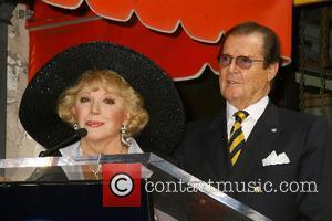 Ruta Lee and Roger Moore