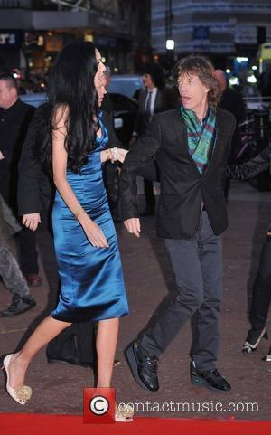 Mick Jagger and L'wren Scott
