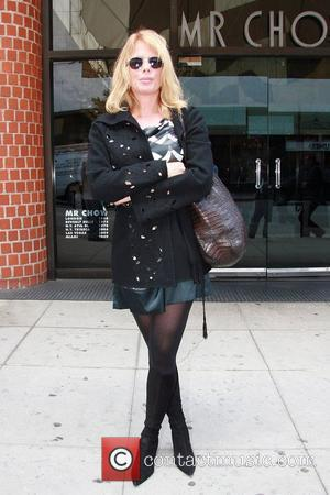 Arquette Accepts Damages After News Of The World Drug Story