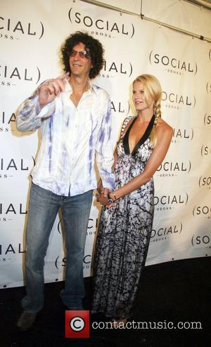 Howard Stern and Beth Ostrovsky Arrives at the Hampton Social @ Ross concert by Tom Petty at the Ross School...