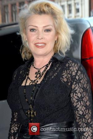 Kim Wilde  leaving the Royal Garden Hotel to go to the Royal Albert Hall for Ali Campbell's concert London,...