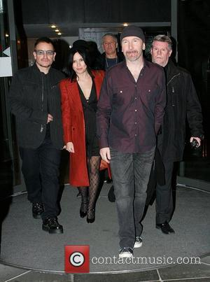 Bono, Adam Clayton and Andrea Corr
