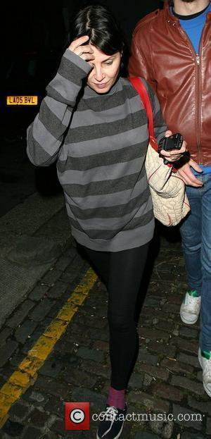 Sadie Frost arrives at the home of Amy Winehouse with a group of friends at 2am, looking rather worse for...
