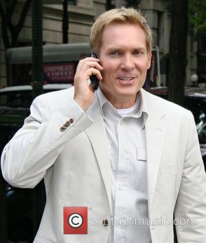 ABC's Meteorologist Sam Champion talking on his cell phone New York City, USA - 09.08.07
