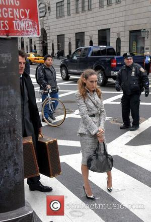 Chris Noth and Sarah Jessica Parker Annie Leibovitz photographs Sarah Jessica Parker for Vogue Magazine on 5th Avenue New York...