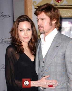 Jolie And Pitt Plan To Adopt Katrina Orphan