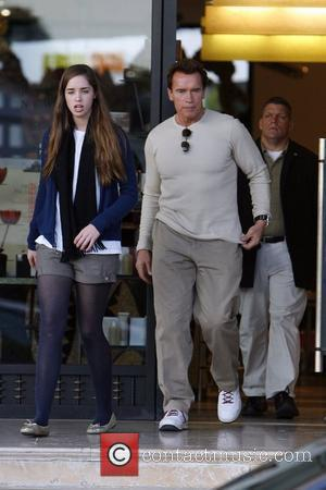 Arnold Schwarzenegger and his daughter shopping at Barney's New York