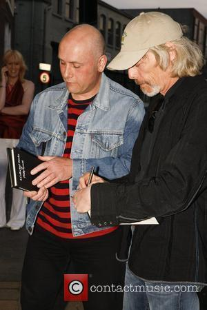 Scott Gorham (right) of Thin Lizzy attends the launch of 195 limited edition signed prints of Black Rose album cover...