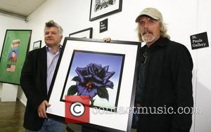 Scott Gorham of Thin Lizzy presents one of the 195 limited edition signed prints of Black Rose album cover to...