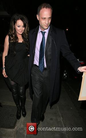 Sarah Brightman leaving Scott's seafood restaurant, looking worse for wear, and having her face covered by a mystery man. London,...
