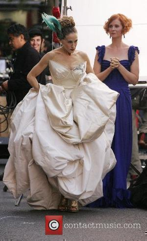 Cynthia Nixon, Sarah Jessica Parker  on the film set for 'Sex And The City: The Movie' New York City,...