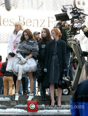 Kim Cattrall, Sarah Jessica Parker, Kristin Davis and Cynthia Nixon film a scene for 'Sex And The City: The Movie'...