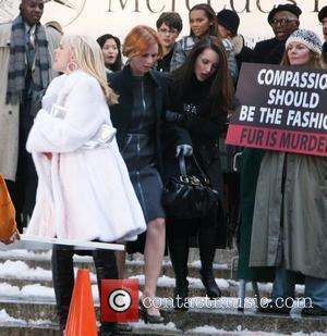 Kim Cattrall, Cynthia Nixon and Kristin Davis film a scene for 'Sex And The City: The Movie' at Bryant Park...