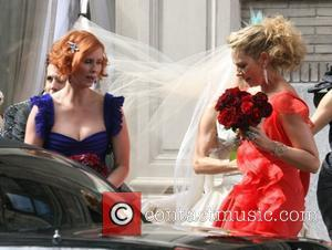 Kim Catrall and Cynthia Nixon filming a wedding scene for 'Sex And The City: The Movie' New York City, USA...