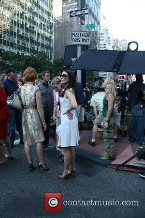 Kristin Davis, Sarah Jessica Parker, Cynthia Nixon The stars of 'Sex and the City: The Movie' appear together on set...
