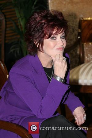 Sharon Osbourne poses for pictures at the O2 Arena to promote the auction of items from the family's homes in...