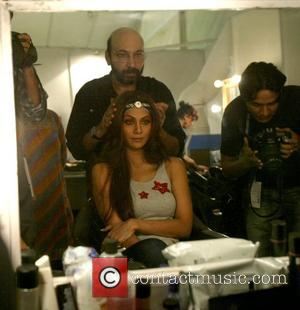 Shilpa Shetty in her dressing room, getting her hair and make-up fixed for her appearance in India Fashion week New...