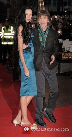 L'Wren Scott and Mick Jagger of The Rolling Stones UK premiere of 'Shine A Light' held at Odeon Leicester Square...