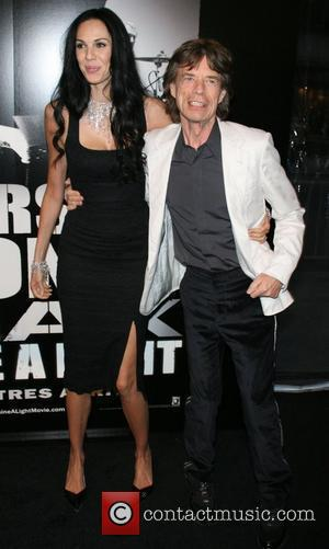 L'Wren Scott and Mick Jagger of the Rolling Stones New York Premiere of 'Shine a Light' held at the Ziegfield...