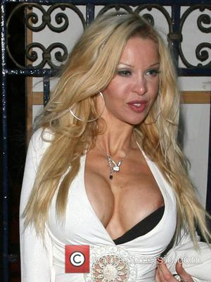 Alicia Douvall with two huge suitcases of free gifts and her nipple popping out at the Shoestring: World On Your...