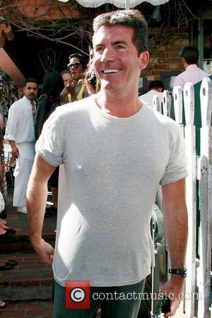 Cowell Humiliated By 'Man Boobs'