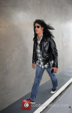 Slash `Relieved' About Weiland's Departure
