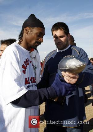 Snoop Dogg and Matt Leinart holding the Snoop Bowl Trophy. Snoop Bowl VI at Hamilton High School Chandler, Arizona 02.02.08