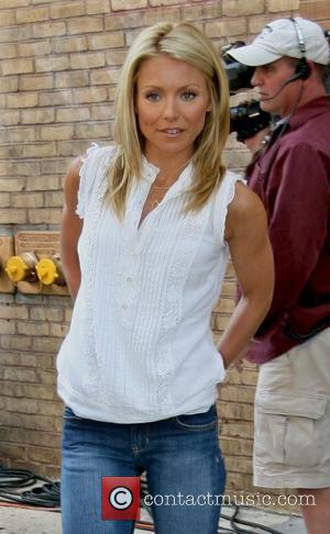 Kelly Ripa Soap Box Derby racing outside ABC Studios for the 'Live with Regis and Kelly' show New York City,...