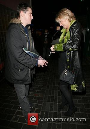 Ingrid Tarrant gives a beggar some money,  Charity fundraising party in aid of the Stroke association held at the...