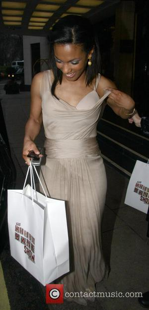 Freema Agyeman flashes her bra  The South Bank Show Awards at The Dorchester Hotel - Departures London, England -...
