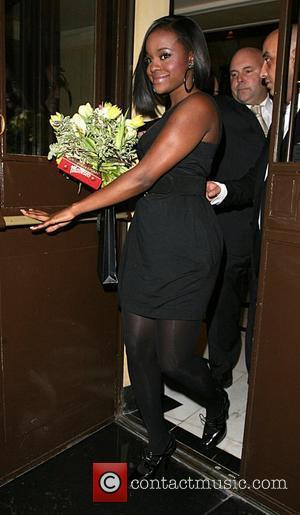 Keisha Buchanan leaving the Dorchester hotel with a big bunch of flowers and a box of chocolate, after performing with...