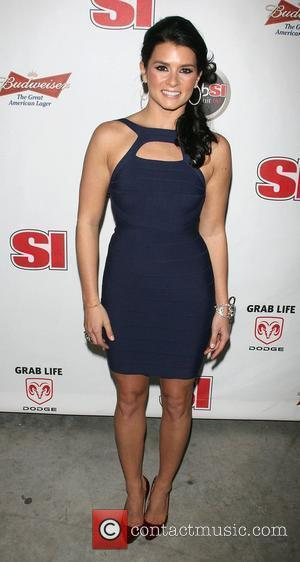 Danica Patrick Sports Illustrated makes a splash at the launch of the 2008 swimsuit issue, held at number 7 World...